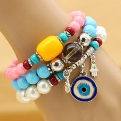 دستبند زنانه چند تکه با سنگ های رنگی و آویز چشم نظر مدل B242