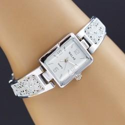 ساعت مچی زنانه استیل با صفحه مستطیل شکل و سفید رنگ مدل F157
