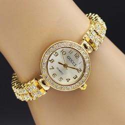 ساعت مچی زنانه نگین دار جنس استیل و رنگ طلایی و صفحه سفید مدل F160