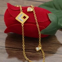 دستبند زنانه دو زنجیره استیل با آویز قلب نگین دار و رنگ طلایی مدل B260