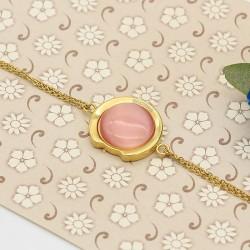 دستبند زنانه سواچ با سنگ صورتی و جنس استیل مدل B313