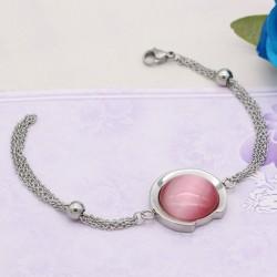 دستبند زنانه سواچ با سنگ صورتی و زنجیر نقره ای جنس استیل مدل B334